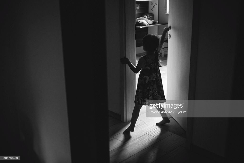 High Angle View Of Girl Closing Door At Home & High Angle View Of Girl Closing Door At Home Stock Photo | Getty ... pezcame.com