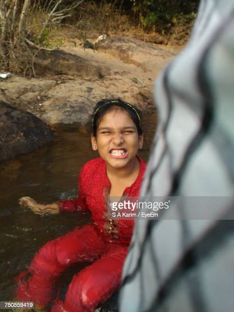 High Angle View Of Girl Sitting In Water