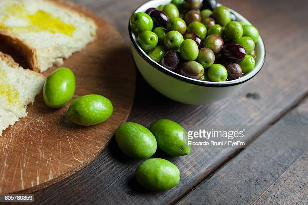 High Angle View Of Green Olives In Bowl On Table