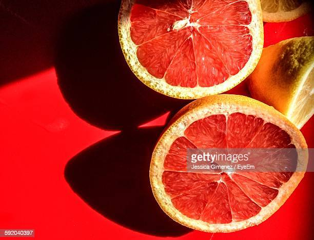 High Angle View Of Halved Blood Orange On Table