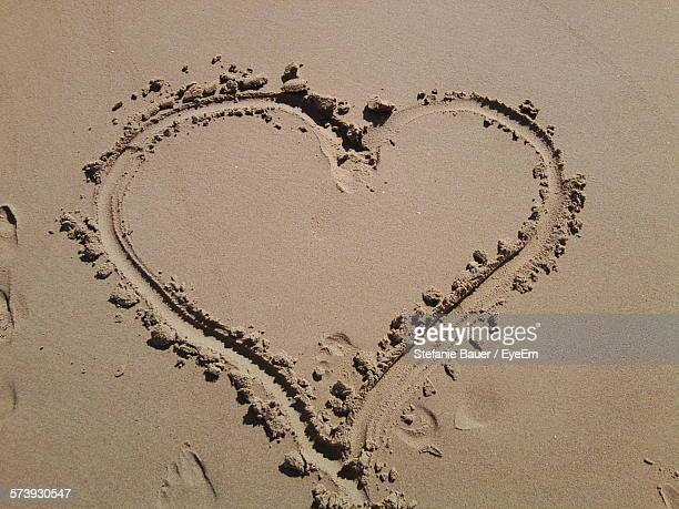 High Angle View Of Heart Shape On Sand At Beach