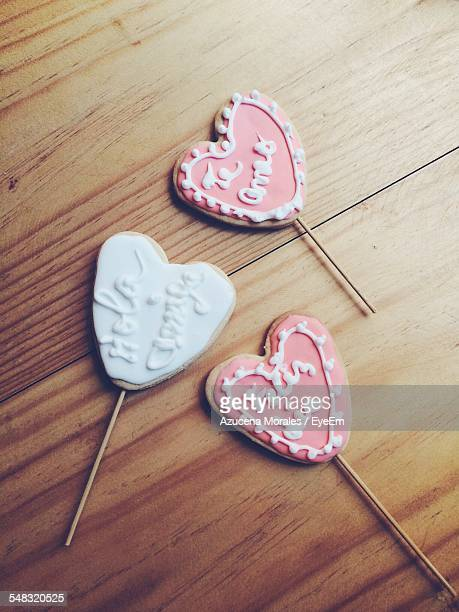 High Angle View Of Heart Shaped Cookie Lollipops