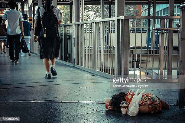 High Angle View Of Homeless Girl On Bridge