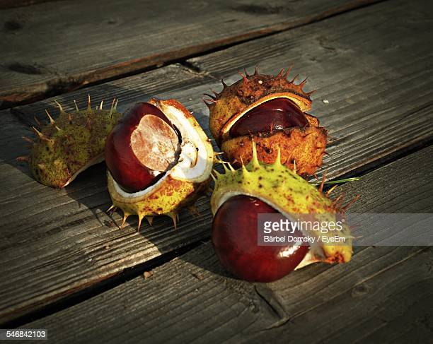 High Angle View Of Horse Chestnuts On Wooden Plank
