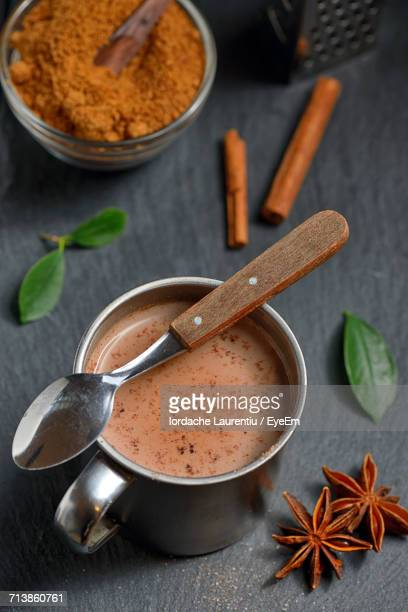 High Angle View Of Hot Chocolate In Mug By Ingredients On Table