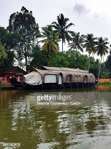 High Angle View Of Houseboat On River Against Palm Trees