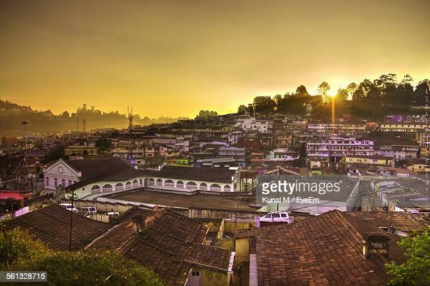 High Angle View Of Houses In Town At Sunset