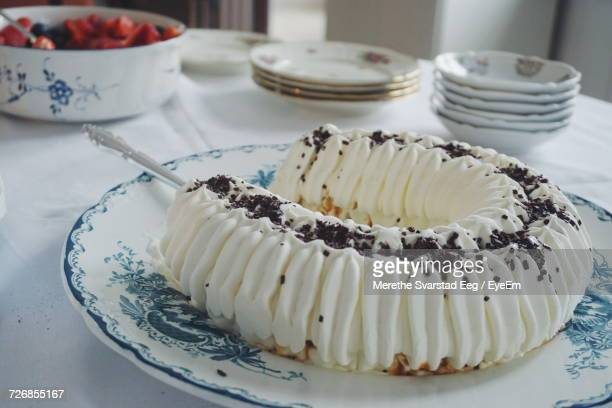 High Angle View Of Ice Cream Cake Served In Plate On Table