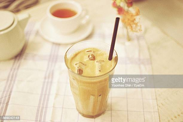High Angle View Of Iced Coffee On Table