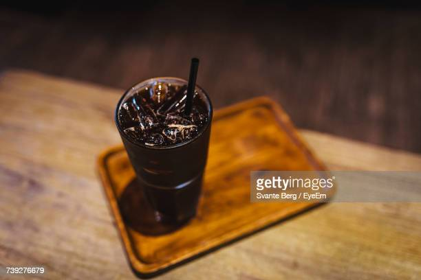High Angle View Of Iced Coffee Served In Tray At Wooden Table