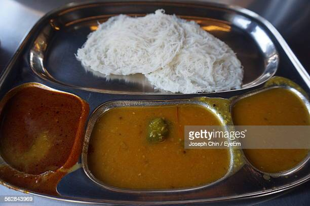 High Angle View Of Idiyappam And Curry Served In Plate