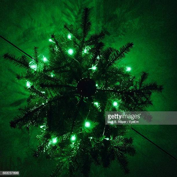 High Angle View Of Illuminated Christmas Tree On Snow Field