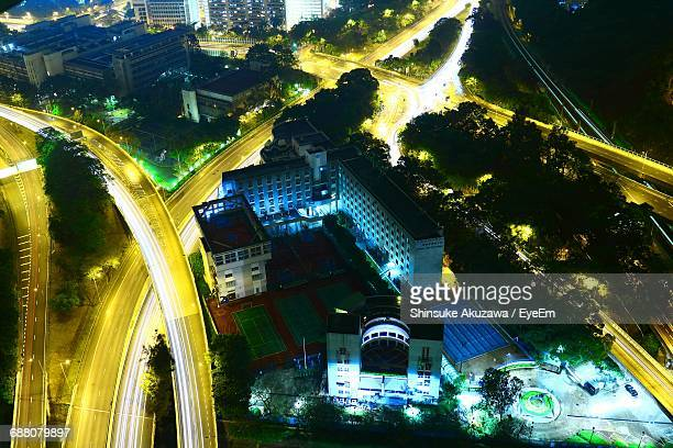 High Angle View Of Illuminated Roads And Buildings In City At Night
