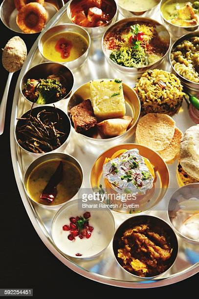 High Angle View Of Indian Thali Served On Table