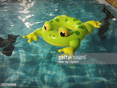 High Angle View Of Inflatable Floating On Swimming Pool At Night