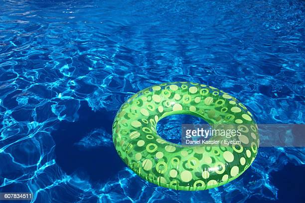 High Angle View Of Inflatable Ring On Swimming Pool