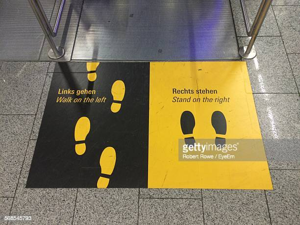 High Angle View Of Information Sign On Floor At Frankfurt International Airport