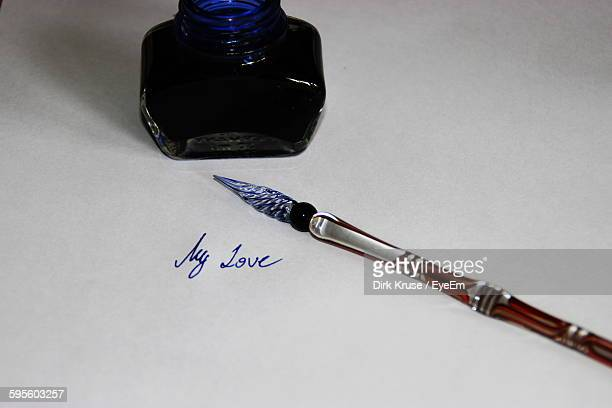 High Angle View Of Ink And Pen