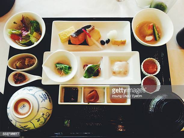 High Angle View Of Japanese Food Served On Table