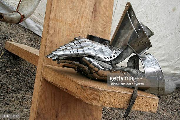 High Angle View Of Knight Gloves On Wood