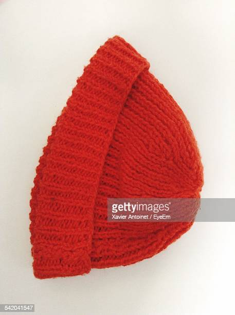 High Angle View Of Knitted Hat On White Table