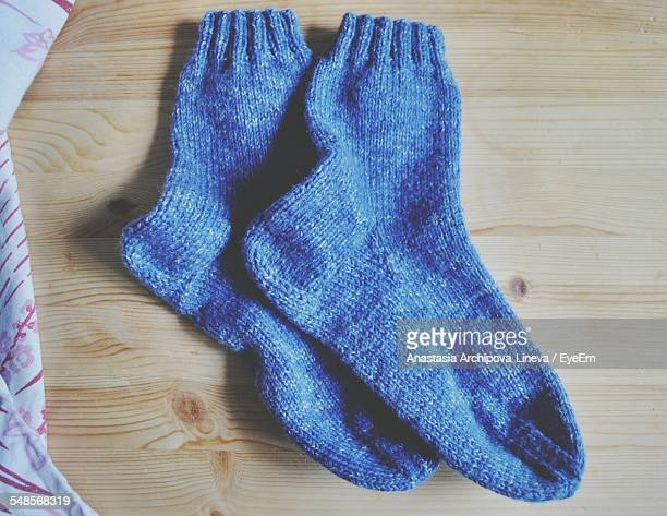 High Angle View Of Knitted Socks On Floor