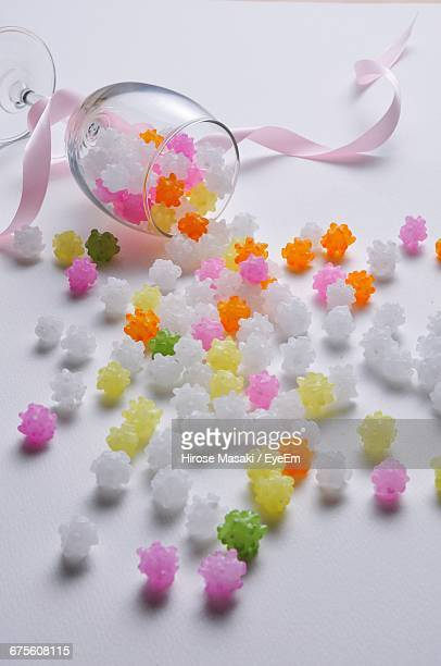 High Angle View Of Konpeito With Wineglass On Table