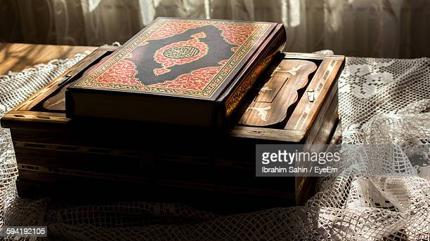 High Angle View Of Koran On Table