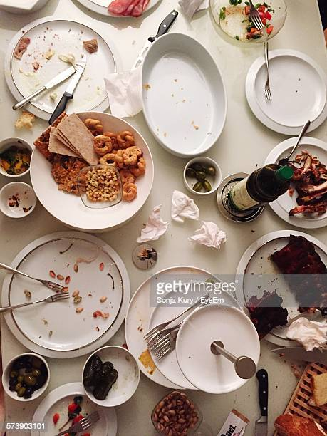 High Angle View Of Leftovers On Dining Table