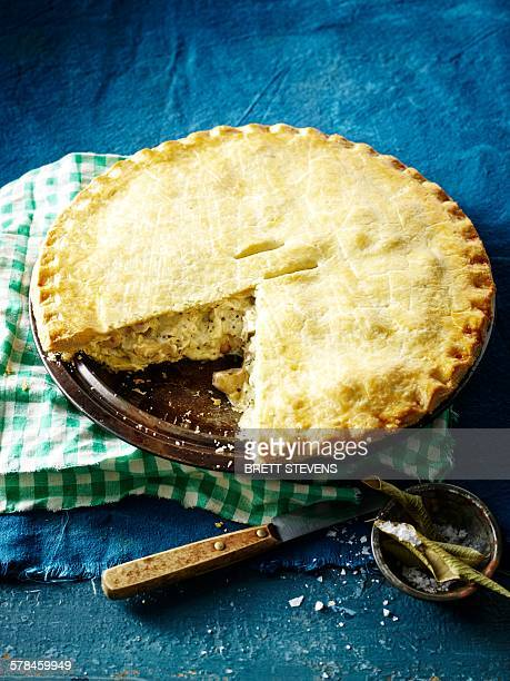 High angle view of lemon myrtle chicken pie, slice missing