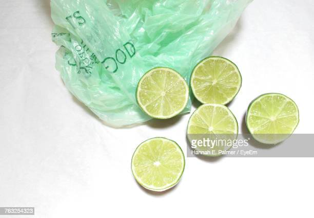 High Angle View Of Lemon Slices Against White Background