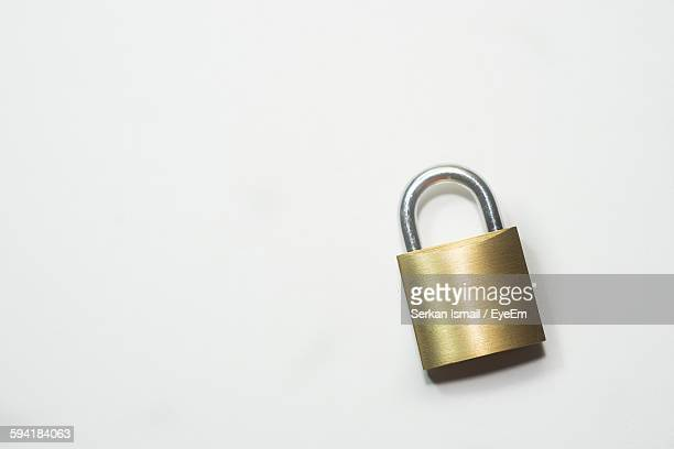High Angle View Of Lock On White Background