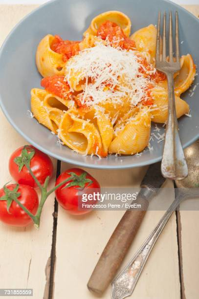 High Angle View Of Lumaconi Pasta Served In Plate On Table