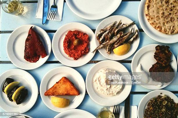 High Angle View Of Lunch Served In Plates On Table