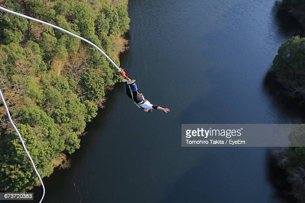 High Angle View Of Man Bungee Jumping Over River