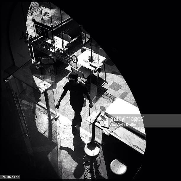 High angle view of man entering restaurant