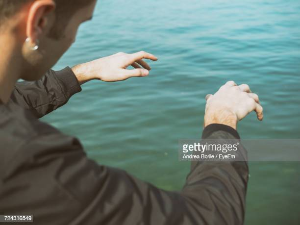 High Angle View Of Man Gesturing Over Sea