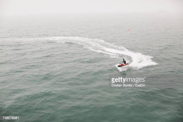 High Angle View Of Man Jet Boating In Sea