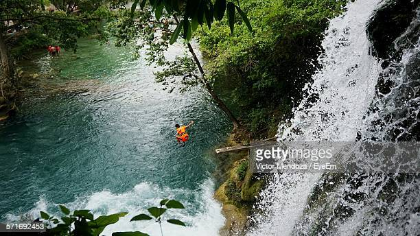 High Angle View Of Man Jumping In River