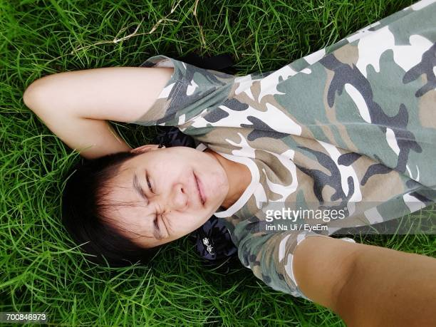 High Angle View Of Man Lying On Grass