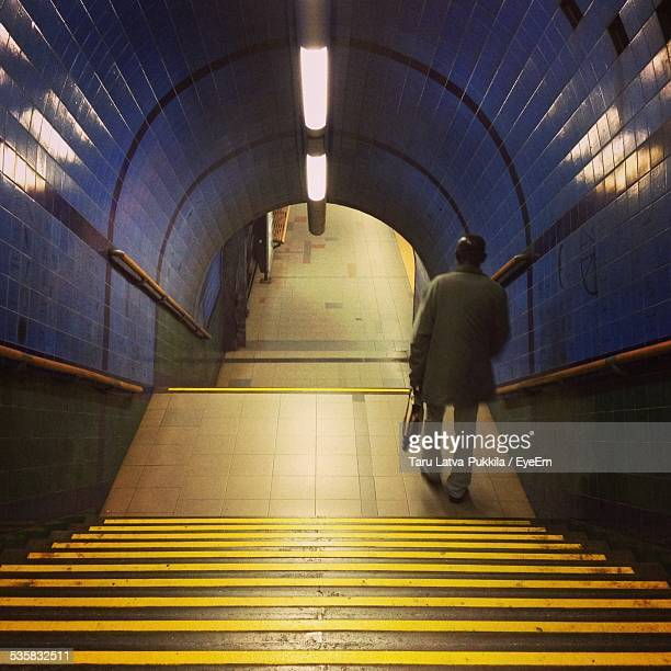 High Angle View Of Man Moving Down Steps Of Subway Station
