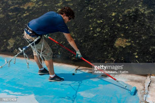 High Angle View Of Man Painting Wall