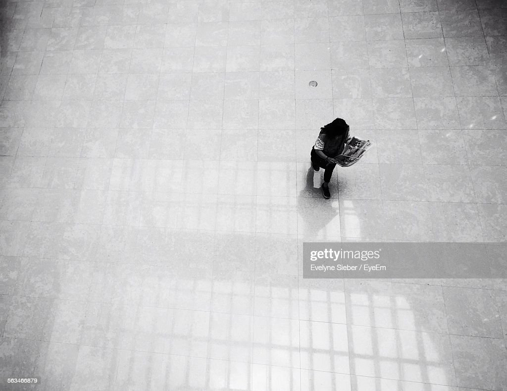 High Angle View Of Man Reading Newspaper