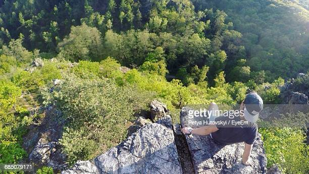 High Angle View Of Man Sitting On Mountain