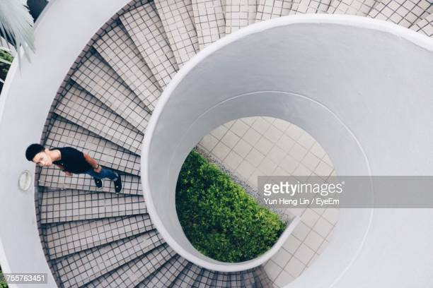 High Angle View Of Man Standing On Spiral Steps