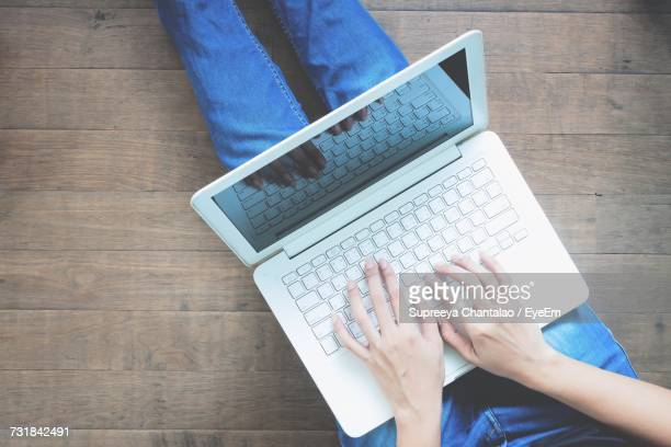 High Angle View Of Man Using Laptop