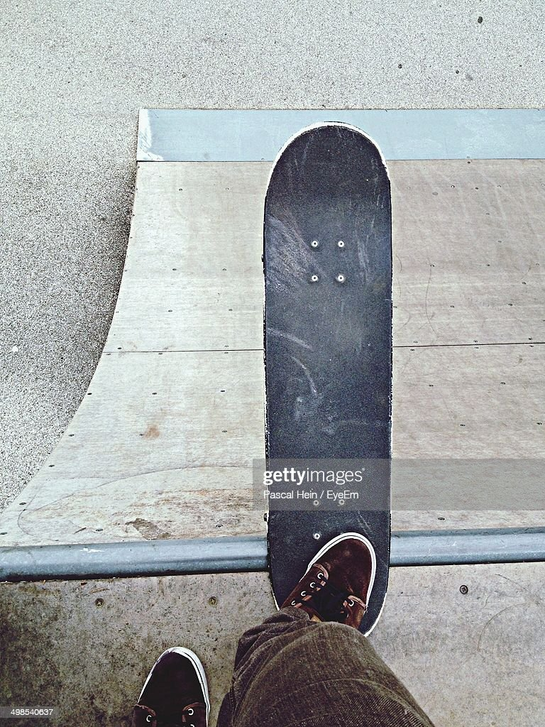 High angle view of man with skateboard in park