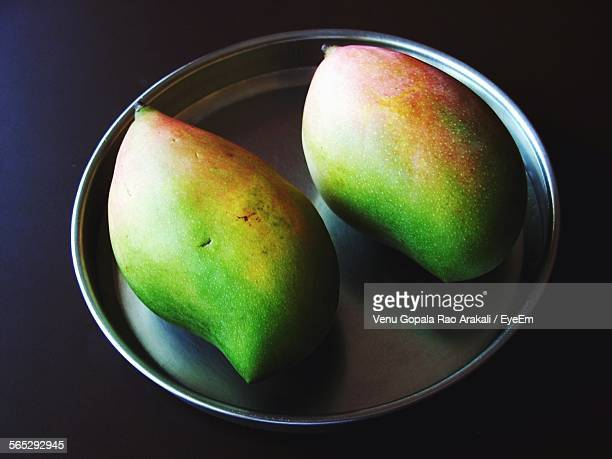 High Angle View Of Mangoes In Plate On Table