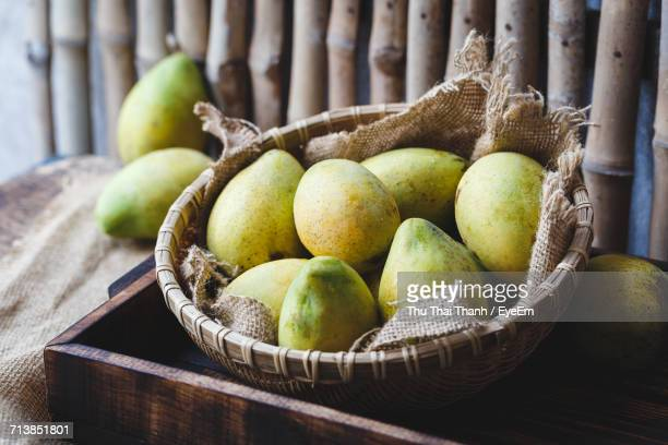 High Angle View Of Mangoes With Burlap In Basket