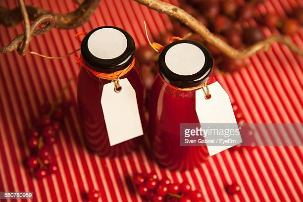 High Angle View Of Marmalade In Bottles On Table